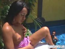 Dude slobbers beautiful ethnic tranny near pool