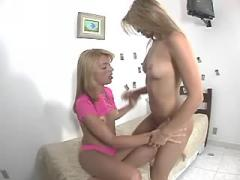 Playful shemale and pretty girl plays with strapon